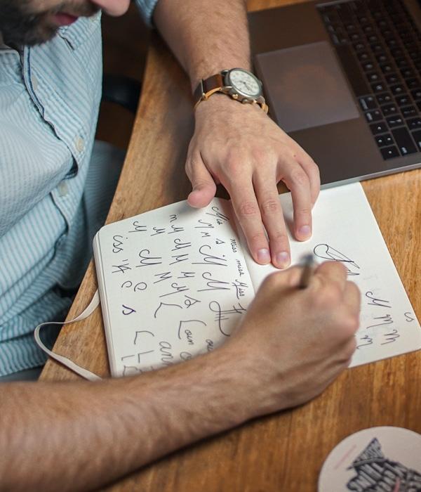 image of man working on branding designs